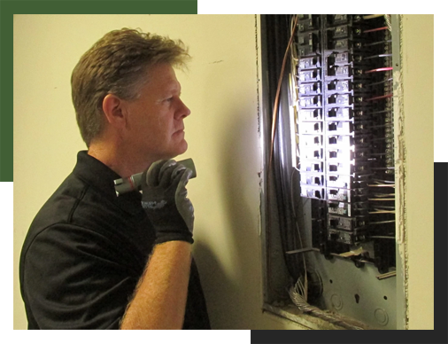 One of our inspectors taking some extra time to investigate the condition of an electrical panel.